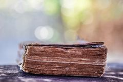 The Old Dictionary on Black Wood, Bokeh Nature Background - Dictionary : Important Knowledge Sources for Everybody. stock photos