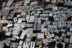 Old die press letters and numbers. Old metal die press letters and numbers Stock Photography