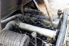old diesel engine of forklift with traces of spilled oil on the valve cover