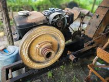 Old diesel engine used in agriculture. Old diesel engine used in agriculture placed on Two-wheeled tractors Royalty Free Stock Images