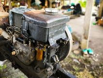 Old diesel engine used in agriculture. Old diesel engine used in agriculture placed on Two-wheeled tractors Royalty Free Stock Photo