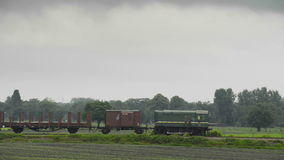 Old Diesel Freight Train. Pulling various railroad cars in the countryside stock video