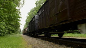 Old Diesel Freight Train. Pulling various railroad cars in the countryside stock footage