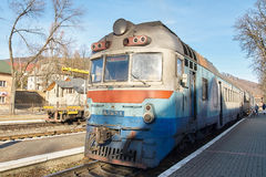 Old diesel passenger train. Railroad station. Stock Photos