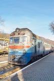 Old diesel passenger train. Railroad station. Royalty Free Stock Photo