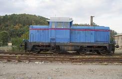 Old diesel railroad train locomotive. Old diesel railroad locomotive in depot Royalty Free Stock Photos