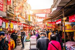 Old Dihua jie shopping street full of people with dramatic ligh in Taipei Taiwan stock images
