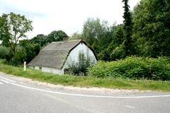 Old dikehouse. A house was built beneath te river dike in the municipality of Hagestein Stock Image