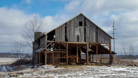 Old dilapidated barn in winter Stock Image