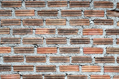 Old and dilapidated brick walls. Brick wall on the old and decaying at the buiding new tower Royalty Free Stock Photography