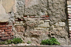 Old dilapidated concrete stone wall  background Royalty Free Stock Photo