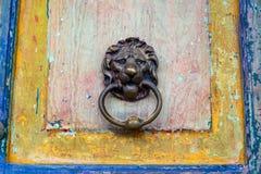 Old Door and Door Knocker. Old dilapidated door with a lion door knocker in Salento, Colombia Royalty Free Stock Images