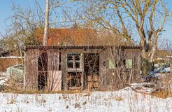 Old dilapidated hut in the snow. In Bavaria, Germany Royalty Free Stock Photos