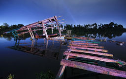 Old dilapidated jetty night shot Stock Photography