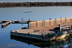Old dilapidated marina platform Stock Photography