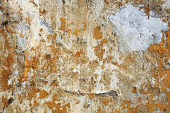 Old dilapidated plastered stone wall Stock Photography