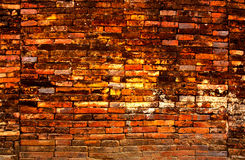 Old and dilapidated red brick wall Stock Images
