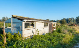 Old dilapidated small shed in a rural area Stock Image