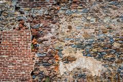 Old dilapidated stone wall with partial brickwork Royalty Free Stock Image