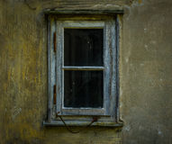 The old and dilapidated window of a  house Royalty Free Stock Images
