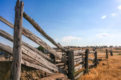 Old dilapidated wooden cattle race fence in the country. Royalty Free Stock Photography