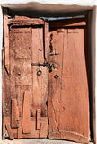 Old dilapidated wooden door. Royalty Free Stock Images