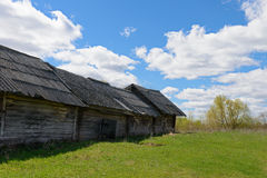Old dilapidated wooden house. On a bright sunny day Royalty Free Stock Images