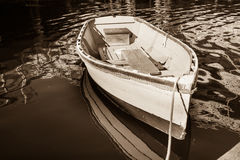 Old dinghy in sepia. Royalty Free Stock Photos