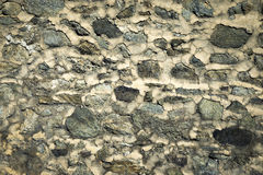 Old dingy and dirty wall of rocks. Abstract background or texture old dingy and dirty wall of rocks Stock Photo