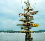Direction sign post on the water stock images