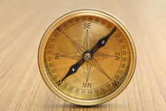 Old directional compass isolated. Closeup of old directional compass isolated on a table stock image
