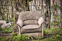 Old dirty armchair Stock Photo