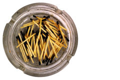 Old dirty ashtray with burnt matches, isolated on white backgrou Royalty Free Stock Photo