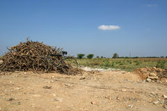 Old dirty bike around piles of firewood, Kerala, South India Stock Image