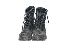 Old dirty black boots. Isolated on a white background royalty free stock images