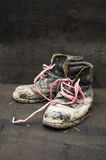 Old dirty black leather shoes. Old dirty black leather shoes on wooden floor Stock Photo