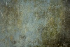 Old dirty blue-green wall with scratches and stains of dirt, mold and moss. rough texture. rough concrete wall. An old dirty blue-green wall with scratches and royalty free stock images