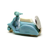 Old dirty blue scooter toy carrying coin isolated on white backg Stock Images