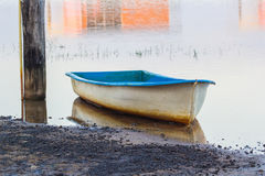 An old dirty boat in river Stock Photography