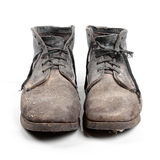 Old dirty boots isolated on white Royalty Free Stock Photos