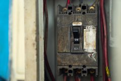 Old and dirty Breakers switch in electric box, circuit breakers, electrical panel, switch with wires royalty free stock photo