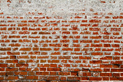 Old dirty brick wall with white and red bricks Stock Photo