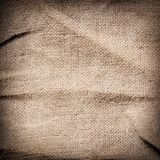 Old dirty brown burlap texture. Square woven Stock Photos