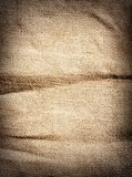 Old dirty brown burlap texture. Vertical woven Stock Image