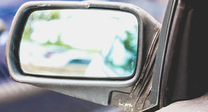 Old dirty car with broken side mirror Royalty Free Stock Photos