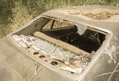 Old Dirty Car with Busted Window Royalty Free Stock Images