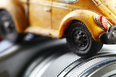 Old and dirty car model put on the camera background scene. Old and dirty car model put on the camera background scene represent travel concept idea Royalty Free Stock Photography