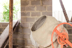 Old dirty cement mixer at a construction site. Old dirty cement mixer at a construction site Royalty Free Stock Photo