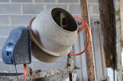 Old dirty cement mixer at a construction site. Stock Photos