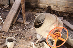 Old dirty cement mixer at a construction site. Stock Photo